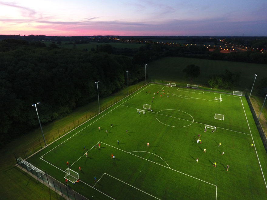 Five a side football under floodlights as the sunsets.