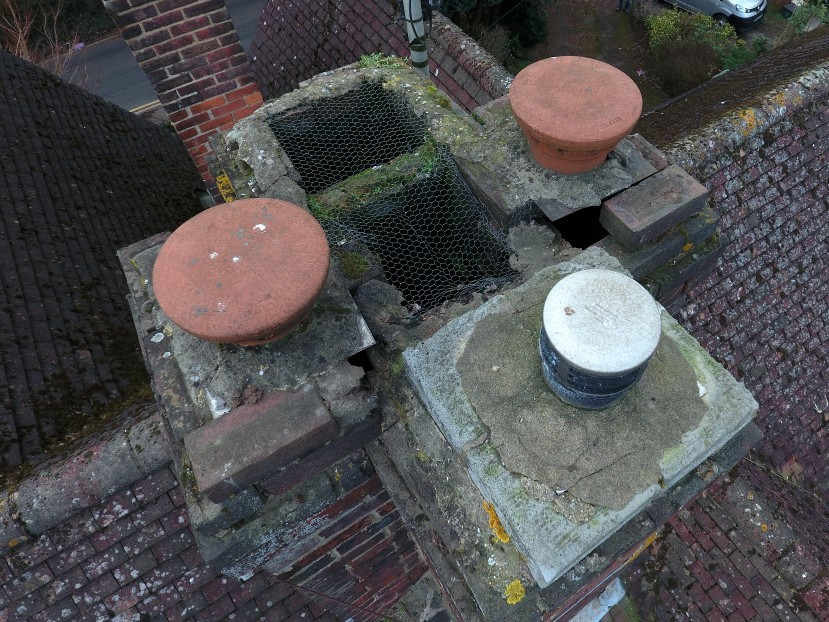 Drone photo of a chimney stack with bricks missing