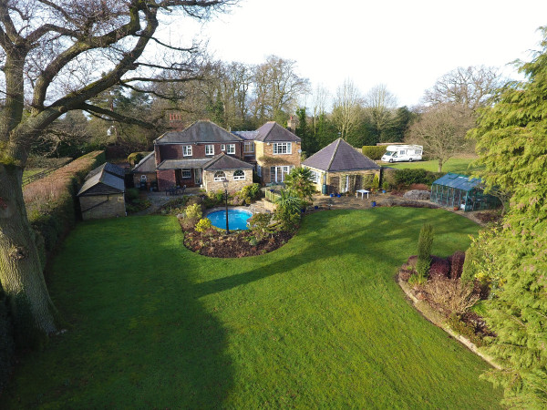 Aerial photo of the landscaped back garden of a detached house