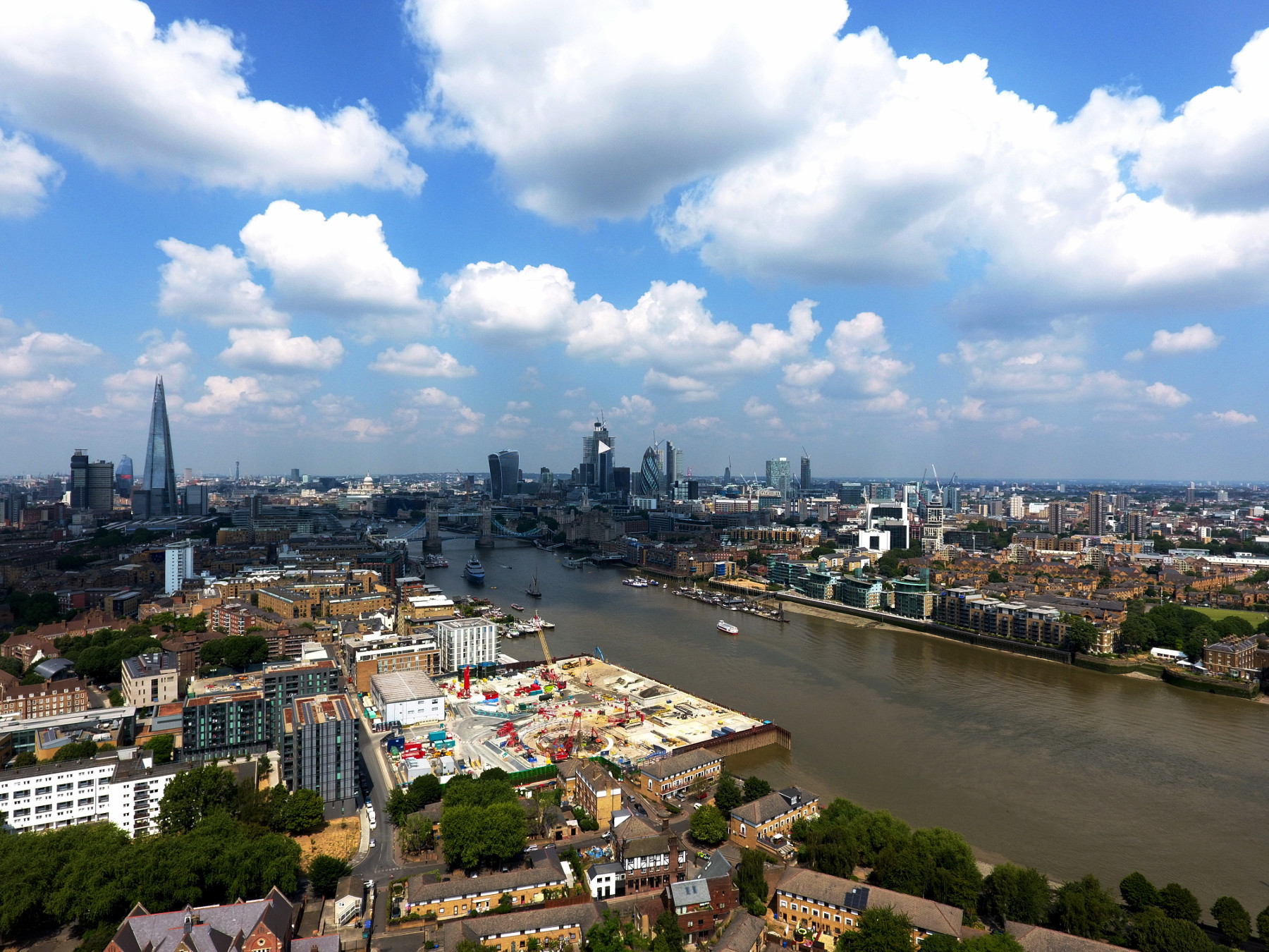 An aerial view of the London skyline on a bright sunny day, overlooking the river Thames from Southwark.